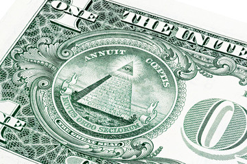 U.S. one (1) dollar bill in a close-up photo.