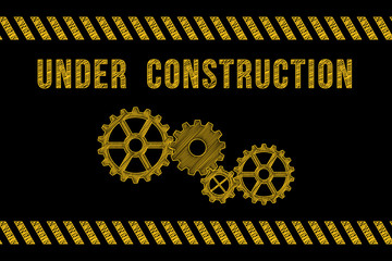 Under construction road sign in yellow on black with stripes