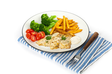 Fried Catfish fillet with vegetables on white background