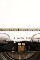 Word I LOVE YOU written on an old typewriter