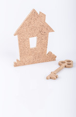 wooden house and key
