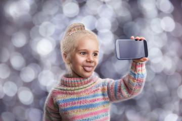 Little girl doing selfie