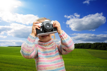 Little girl takes photo of nature