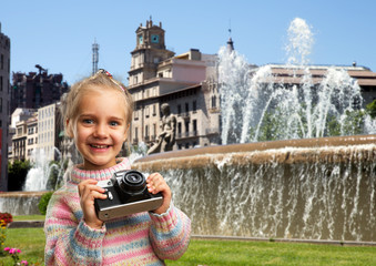 Little girl with retro camera