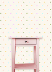 Vintage pink wooden chest drawer near vintage dots wall
