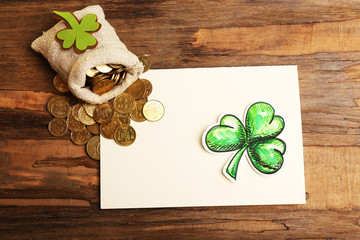 Greeting card for Saint Patrick's Day with shamrock and bag of