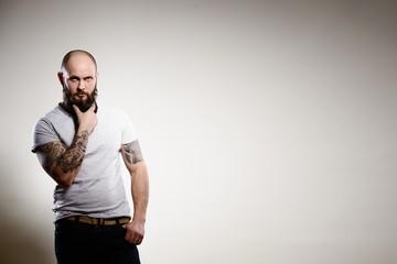 Portrait of tattooed bearded man