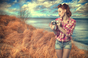 pin-up with a camera