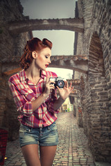 pin-up with a camera.