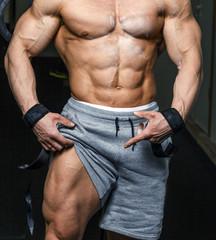 Male body in a gym.