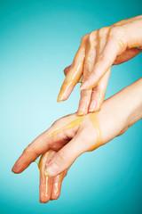 Female hands in honey