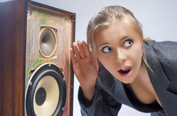 Surprised Caucasian Blond Female Harkens to Outdated Loudspeaker