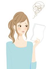 書類を確認する女性 不満