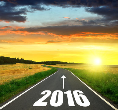 Asphalted road at sunset .Forward to the New Year 2016