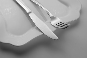 fork with a knife