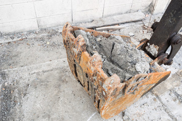 Loader of a excavator (backhoe) with full clay for dredging and