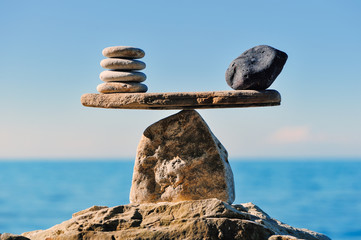 Symbol of scales is made of pebbles