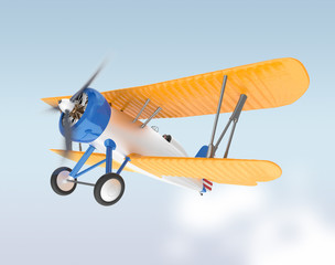 Yellow and silver biplane flying in the sky