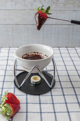 Chocolate fondue, with strawberries