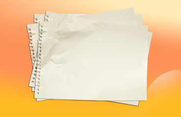 White blank paper on yellow and orange background