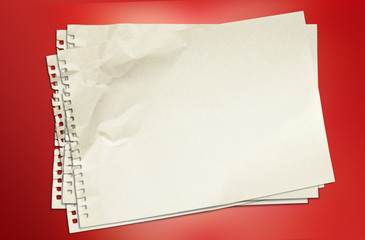 White blank paper on red background