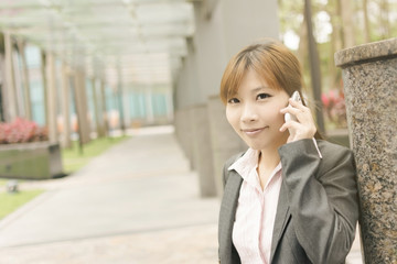 Asian business woman use cellphone