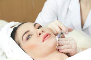 Woman Having Botox Treatment At Beauty Clinic