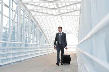 Businessman walking in urban environment of airport