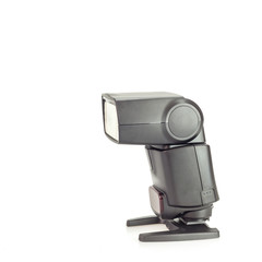 Camera speedlight flash over white