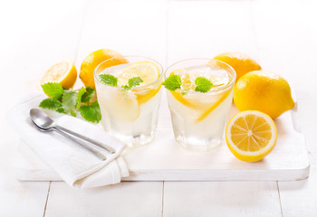 glasses of lemonade with fresh fruits