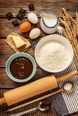 Chocolate cake recipe ingredients on vintage wood