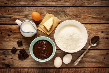 Baking chocolate cake - recipe ingredients on vintage wood