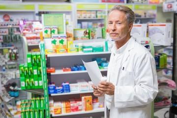 Senior pharmacist holding a prescription