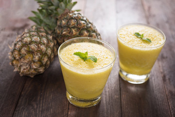 pineapple smoothie on wooden table