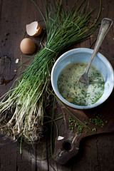 preparing an omelette with fresh beaten eggs and wild chives