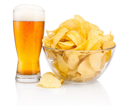 Glass of beer and Potato chips in glass bowl isolated on white b
