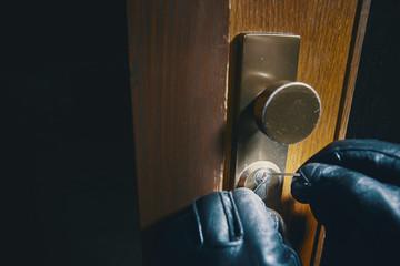 close up burglar picking a lock
