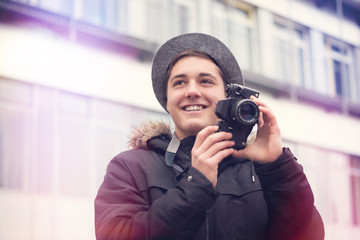 Young creative Hipster with old Camera
