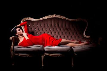 Elegant woman posing on sofa
