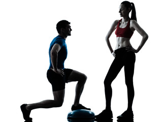 Wall Mural - coach man woman exercising squats on bosu silhouette