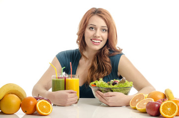 Woman having a table full of organic food,salad,juices,smoothie