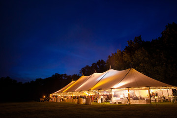 A wedding tent right after sunset