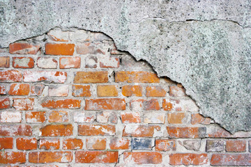 brick wall with broken plaster