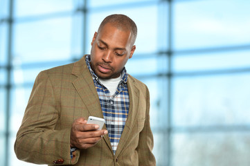 African American Businessman Using Cellphone