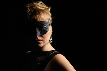 Close up portrait of woman in mysterious mask