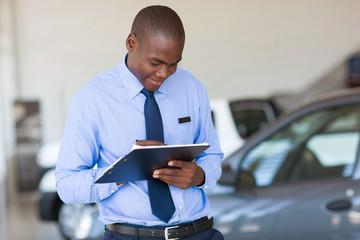 african american man working at vehicle showroom