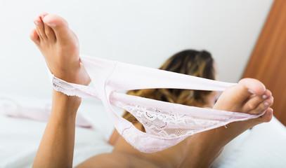 Woman takes off underwear