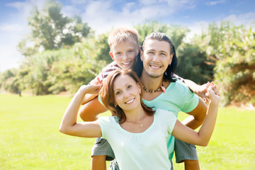 Happy parents with teenager son