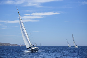 Sailing ship yachts with white sails.