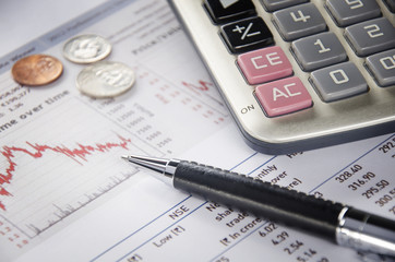 US coins and calculator on financial figure